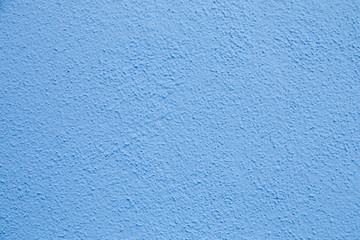 Blue wall background. Painted rought concrete surface texture