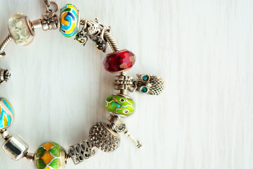 Bracelet with many accessories, luck, money, an owl