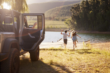 Family Reaching Destination By Lake After Road Trip