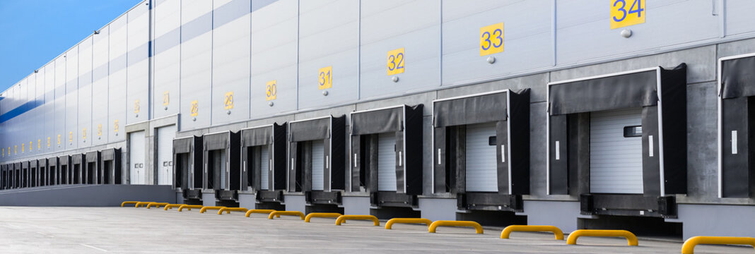 Entrance ramps of a large distribution warehouse with gates for loading goods