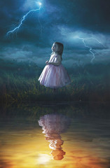 Little girl in rain storm