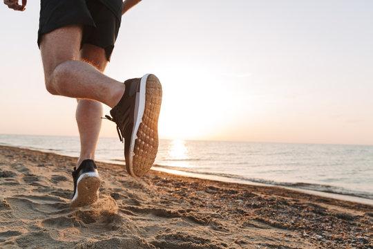 Back view of a sportsmen's legs running
