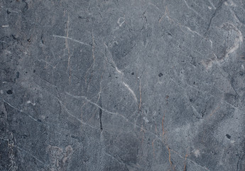 Fragment of stone texture with scratches and cracks. Natural Background.