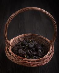 Juicy berries of black mulberry. Many vitamins. Berry season.