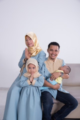 happy young asian muslim family