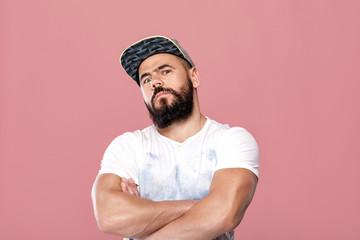 handsome bearded man in cap
