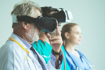 Group of doctor with VR headset on white background