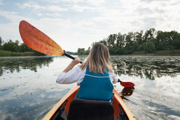 Girl in a kayak on a river
