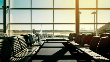 Passenger seat in Departure lounge for see Airplane at Airport terminal, Travel concept with copy space. Silhouette background