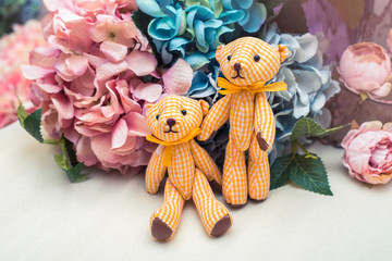 Beautiful toy bears on stylish floral background, shabby chic idea with Teddy bears