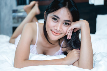 Portrait Asian sexy woman in the bed,Perfect portrait Thailand lady indoors,make sexy eyes