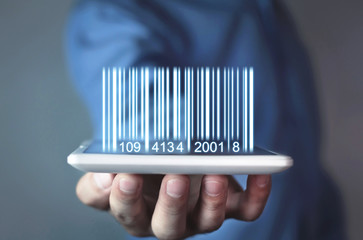 Businessman showing bar code. Warehouse, logistic and financial concept