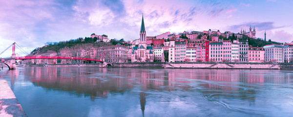 Photo sur Plexiglas Lilas Panoramic view of Saint Georges church and footbridge across Saone river, Old town with Fourviere cathedral at gorgeous sunset in Lyon, France