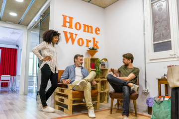 People sitting in creative meeting room