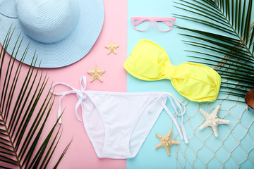 White swimsuit with starfishes and palm leafs on colorful background
