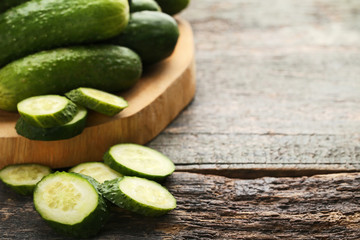 Sliced cucumbers on grey wooden table