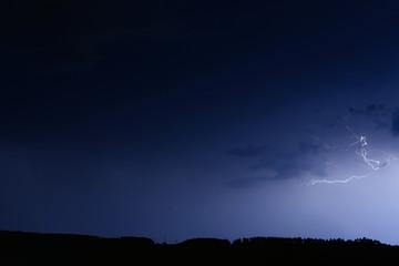 Thunderstorm in blue dark sky
