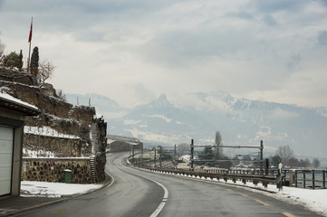 A winding road towards the mountains.