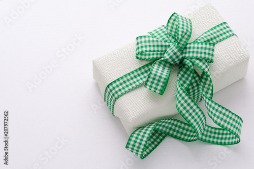 Gift With Checkered Green Ribbon On A White Background Fathers Day
