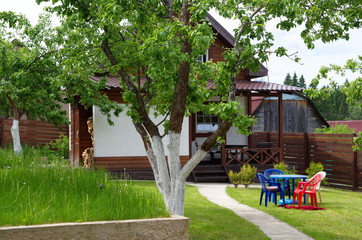 Wooden country house in summer day