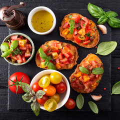 Italian bruschetta with chopped tomatoes and basil   on grilled crusty bread.