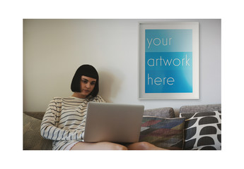 White Framed Poster with Laptop User at Home Mockup