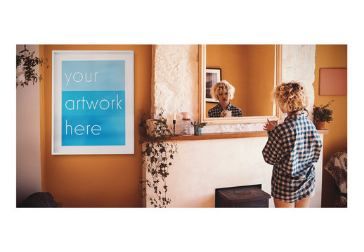 White Framed Poster with Woman Looking in Mirror Mockup