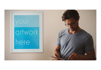 White Framed Poster with Man Using Smartphone Mockup