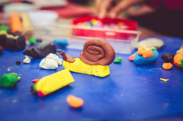 creating animals with play dough