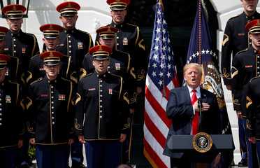 """U.S. President Trump holds hand over heart for anthem at """"celebration of America"""" event at the White House in Washington"""