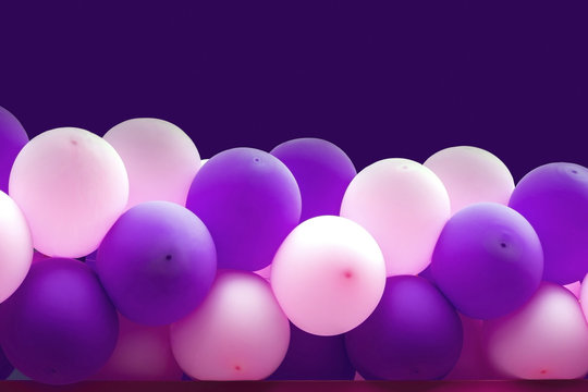 Bundle of balloons pink and purple background
