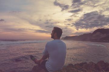 Man enjoying the view on the tropical ocean/sea. Summer concept.