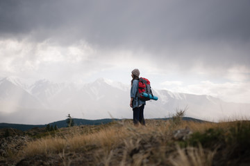 Girl with backpack on nature