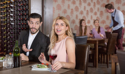 Couple enjoying wine on date in restaurant