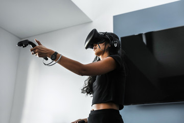 South-East asian girl playing VR game