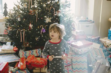 Boy playing with new harmonica on Christmas morning.