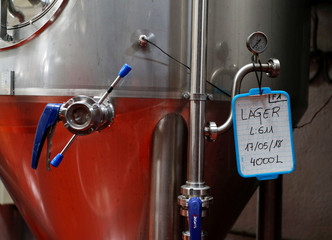 A sign indicating the type of beer hangs on a vat at the Cibeles microbrewery in Leganes, near Madrid