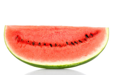 Sweet watermelon slice, front view, over white. Large ripe fruit of Citrullus lanatus with green striped skin, red pulp and black seeds. Edible, raw and organic. Food photo, closeup.