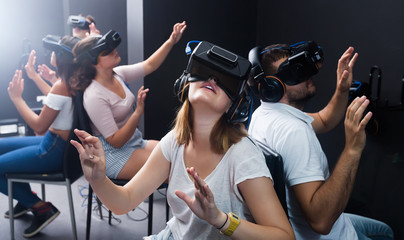 females and males enjoy virtual reality in the glasses