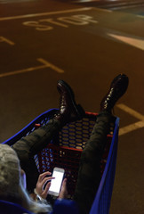 Woman using phone in trolley