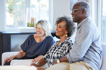 Group of smiling multi-ethnic seniors listening to a talk/ lecture
