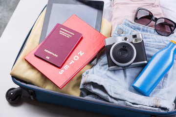 flat lay packed clothes luggage for summer holiday vacation