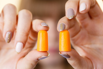 Woman holding protective earplugs