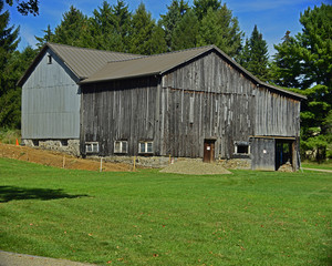 Well maintained old wood barn