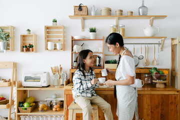 Kid enjoying family time in the kitchen