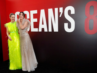 "Cast members Sarah Paulson and Sandra Bullock pose as they arrive at the world premiere of the film ""Ocean's 8"" at Alice Tully Hall in New York City"