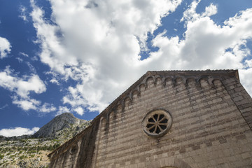 Decorated stone exterior of a building in Kotor, Montenegro.