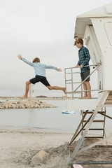 Brothers Jumping off a Lifeguard Tower