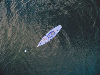 Aerial view of blue yacht