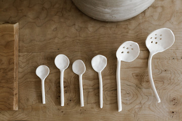 white spoons on natural wooden table